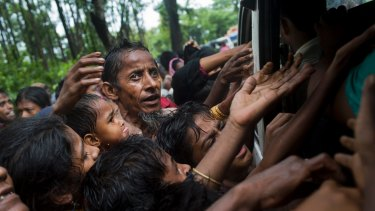 Rohingya scuffle to get aid from local volunteers at Kutupalong, Bangladesh, on Friday.