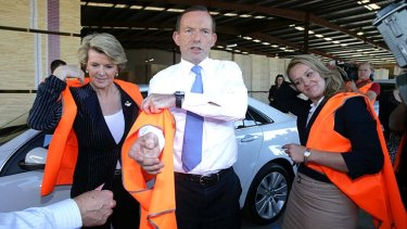 Julie Bishop, pictured with prime mnister-elect Tony Abbott and new LIberal MP Fiona Scott, says she's never considered herself a 'token woman'.