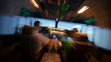 In control … Amanda Hooton and pilot Julian D'Arcy.