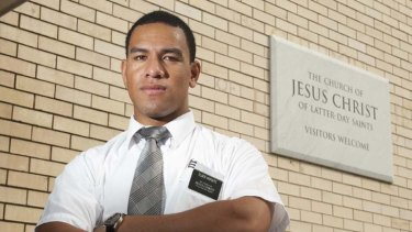 Devout ... William Hopoate poses for a portrait outside a Mormon Church in Beenleigh.