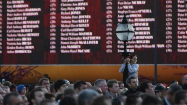 A giant screen displays the nakes of the victims of the Hillsborough disaster.
