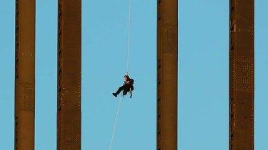 High drama ... Michael Fox on the Harbour Bridge yesterday.