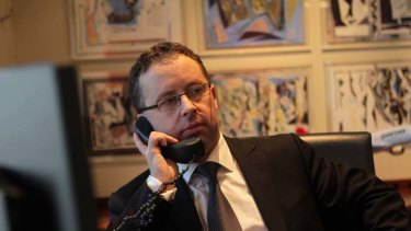 Chief executive Alan Joyce is remaining calm as the pressure mounts on him at the Qantas head office in Sydney yesterday.