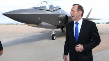 Tony Abbott with a replica of a Joint Strike Fighter.