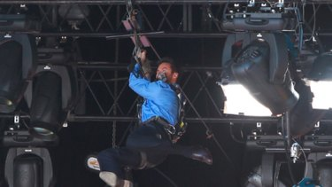 Hugh Jackman is tangled in rigging after his flying fox entrance fails.