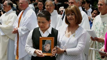 Traumatised: Kim Nguyen at the funeral of her son Van after he was executed in 2005.