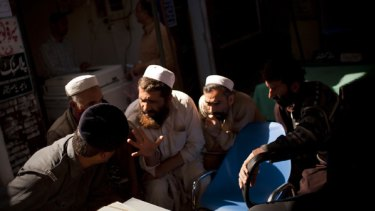 Rule of law ... Pakistani men and a policeman in Rawalpindi's Civil Court this week.