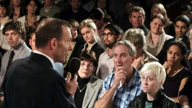 Opposition Leader Tony Abbott with local swinging voters at the Brisbane Broncos Leagues Club in Queensland.
