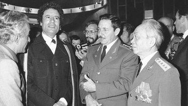 General Vo Nguyen Giap (right) with Muammar Gaddafi (second left) and Cuba's Raul Castro (second right) in Algeria in 1979.