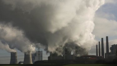 Smoke billows from the RWE brown coal power plant in Neurath, west of Cologne, Germany.