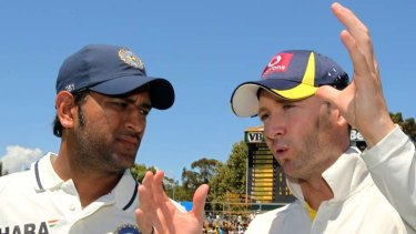 Indian captain MS Dhoni and Australian skipper Michael Clarke chat after Australia won the third cricket Test match by an innings and 37 runs.