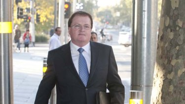 PricewaterhouseCoopers partner Stephen Cougle leaves the Federal Court in Melbourne.