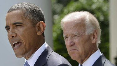 Barack Obama speaks about Syria next to Vice President Joe Biden at the Rose Garden of the White House on Saturday.