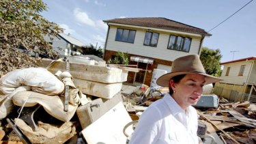 Queensland Premier Anna Bligh tours the devastated Brisbane suburb of Rocklea yesterday.
