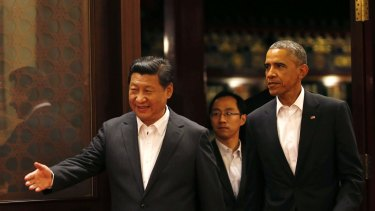 Polite host: China's President Xi Jinping and US President Barack Obama at the Asia Pacific Economic Co-operation summit in Beijing.