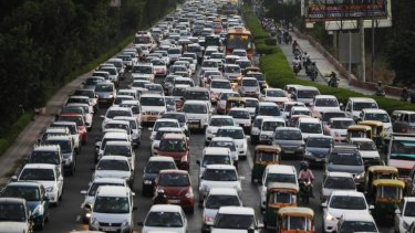 Traffic moves at dusk in New Delhi, India. CO2 emissions continue to rise across the world, making it harder to halt climate change.