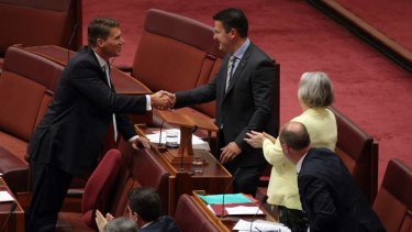 Senator Cory Bernardi congratulates Senator Zed Seselja after he delivered his maiden speech in the Senate.