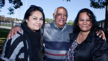 Tracey Robinson mother of Nathan Merritt, Chistine Robinson, mother of Reece Robinson, with their father Eric Robinson at Redfern Oval on Friday.