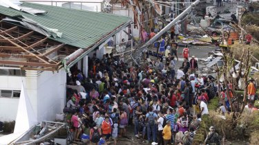 Residents queue up to receive treatment and relief supplies at Tacloban airport following Friday's Typhoon Haiyan that lashed this city and several provinces in central Philippines.