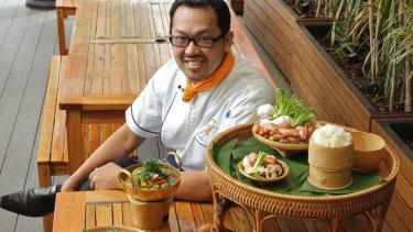 House special ... chef Sujet Saenkham with a selection of his popular Isaan dishes.