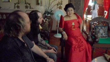 Brisbane filmmakers Andrew Leavold and Danny Palisa with Imelda Marcos.