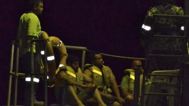 Asylum seekers rescued from a boat that capsized on Tuesday.