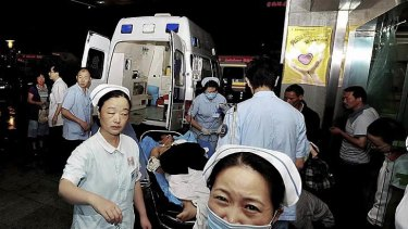 An injured man from a Foxconn factory, on a stretcher, arrives at a hospital in Chengdu on May 20, 2011.