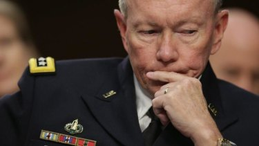 Possibility of troops on the ground: Chairman of the Joint Chiefs of Staff Army Gen. Martin Dempsey testifies before the Senate Armed Services Committee on Capitol Hill.