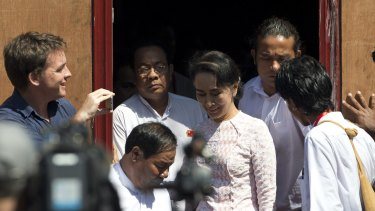 Leader of Myanmar's National League for Democracy party, Aung San Suu Kyi leaves NLD headquarters after delivering a speech to her supporters in Yangon on Monday.