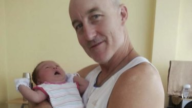 Kevin Lee, the Australian ex-priest who has died in the Philippines during Typhoon Haiyan, with daughter Michelle.