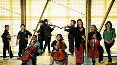 Students from Meadows Primary School build their confidence through music-making with the help of MSO viola teacher Danielle Arcaro (left) and in-school co-ordinator Helen Hatzikalis.