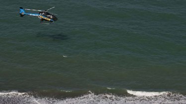 A   police helicopter searches the waters of the Gulf of California for survivors of a capsized fishing boat.