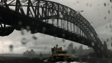Heavy rain showers Sydney, but the prospects for Mardi Gras look a little brighter.