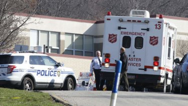 Emergency responders gather in the parking lot of the Franklin Regional High School where 19 students and one adult were stabbed on Wednesday. The suspect, a male student, was taken into custody and being questioned.