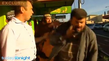 Omar Ammouche punches community leader Jamal Daoud.