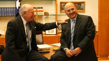 Former PM John Howard, pictured with Arthur Sinodinos in 2006, has released a statement in support for his former chief of staff.