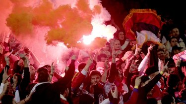A flare lights up Serbian fans at last night's soccer friendly.