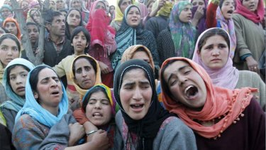 Families scarred by violence ... women mourn at a funeral in Khan Sahib, west of Srinagar, after one person was killed in another militant attack.