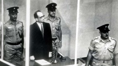 """Guilty before God"" ... former senior Nazi Adolf Eichmann stands in a glass cage during his 1961 trial in an Israeli court, which sentenced him to death."