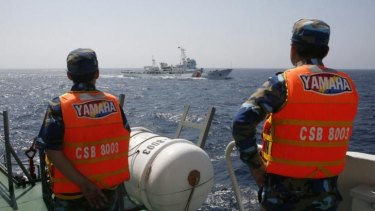 Sharp eye: Vietnamese Marine Guard monitor a Chinese coast guard vessel in the South China Sea in May.
