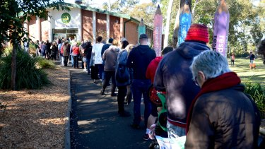 Voters line up outside a polling station in Sydney on Saturday.