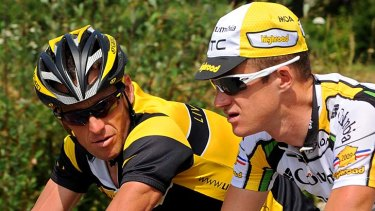 Bad news ... Lance Armstrong chats to Australia's Michael Rogers during the 2009 Tour de France. Rogers faces the prospect of another investigation after he was mentioned in USADA's report.