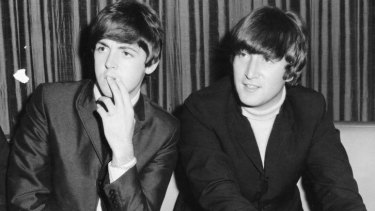 Paul McCartney and John Lennon at Sydney press conference June 1964.