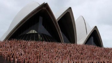 Getting their kit off in the name of art ... participants pose at the Opera House this morning.