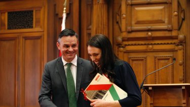 New Zealand Green Party leader James Shaw, left, and then Prime Minister-designate Jacinda Ardern after signing a confidence and supply deal after the NZ election.