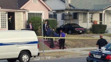 Los Angeles County coroner's officials remove the body of April Jace.