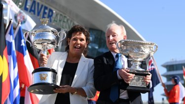 Former tennis players Evonne Goolagong Cawley (left) and Rod Laver hold the men's and women's trophies ahead of the round one matches on day one of the Australian Open in Melbourne.