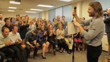 We're in the money: Gravity employees react after being delivered the news.