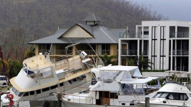 A clutter of boats and yachts are piled together at Port Hinchinbrook after Cyclone Yasi.