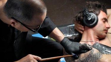 Japanese tattoo artist Horihiro using the wabori technique on a sleeve design for Rob O'Neill.